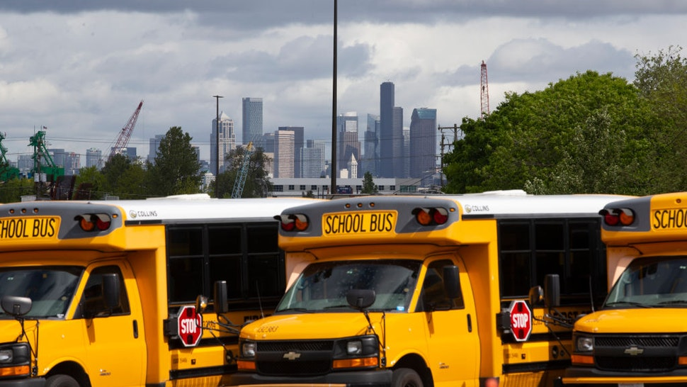 School buses sit idle in a bus yard on May 6, 2020 in Seattle, Washington.