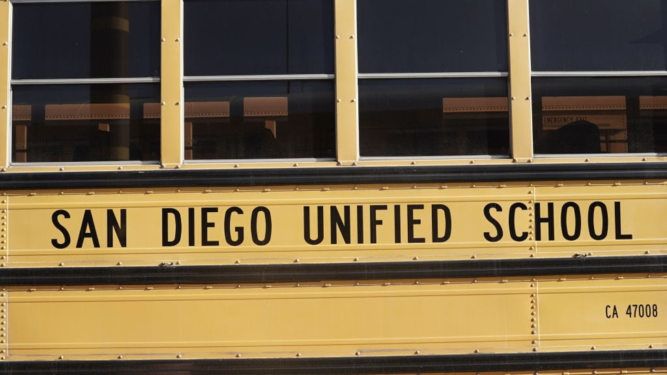 San Diego Unified School District signage is seen on a Navistar International Corp. school bus at the San Diego Unified School District Transportation Department in San Diego, California, U.S., on Thursday, July 9, 2020.