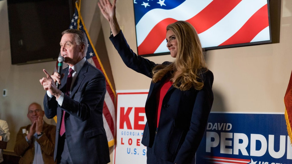 U.S. Sen David Perdue (R-GA) and Sen Kelly Loeffler (R-GA) speaks at a campaign event to supporters at a restaurant on November 13, 2020 in Cumming, Georgia.