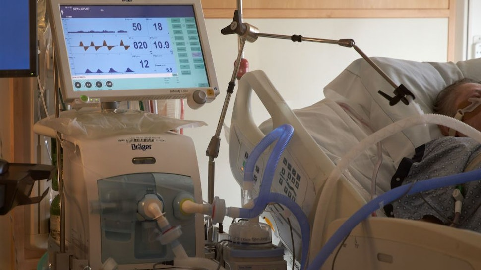 A Covid-19 positive patient is seen on a ventilator at UMass Memorial Hospital in Worcester, Massachusetts on December 4, 2020.