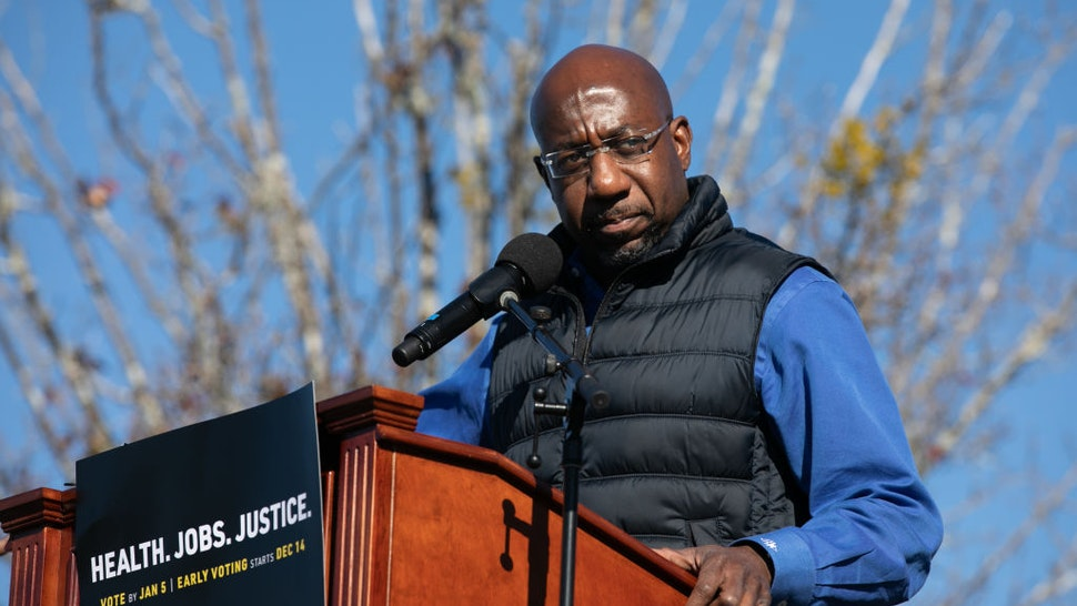 Democratic U.S. Senate candidate Raphael Warnock speaks to the crowd during an outdoor drive-in rally on December 5, 2020 in Conyers, Georgia.