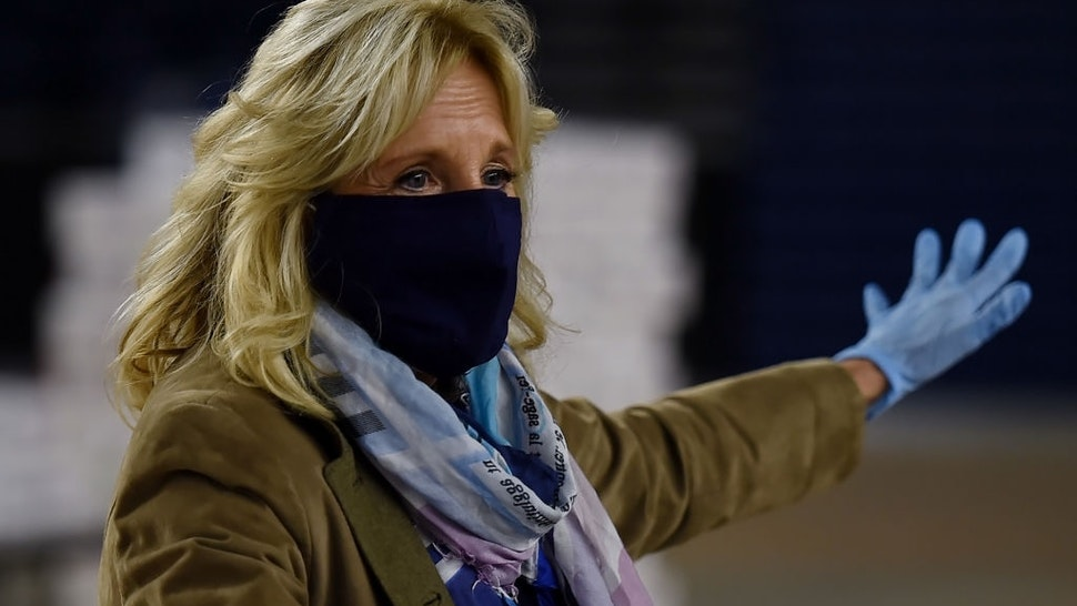 Jill Biden speaks to the press as she joins Operation Gratitude to assembles care packages for deployed US troops, on December 10, 2020, in Washington, DC.