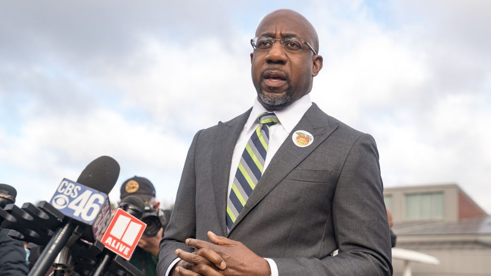 Democratic nominee for U.S. Senate Rev. Raphael Warnock casts his vote in the runoff election on the first day of early voting on December 14, 2020 in Atlanta, Georgia.
