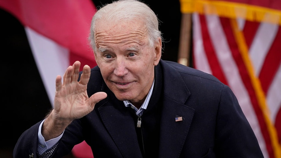 U.S. President-elect Joe Biden gestures to the crowd as he delivers remarks during a drive-in rally for U.S. Senate candidates Jon Ossoff and Rev. Raphael Warnock at Pullman Yard on December 15, 2020 in Atlanta, Georgia.