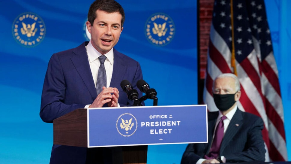 WILMINGTON, DELAWARE - DECEMBER 16: Former Democratic presidential candidate Pete Buttigieg speaks as U.S. President-elect Joe Biden (R) looks on after he was nominated to be Secretary of Transportation during a news conference at Biden's transition headquarters on December 16, 2020 in Wilmington, Delaware.