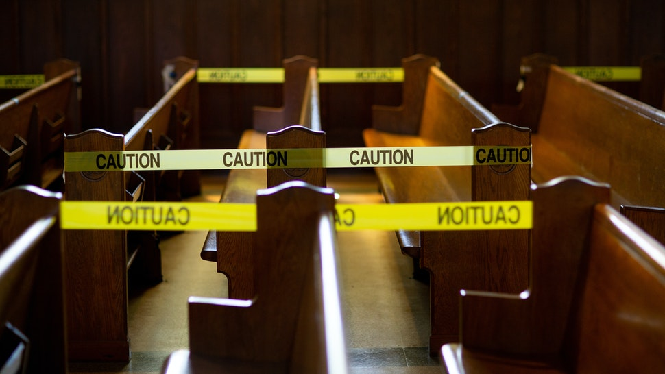 Caution tape blocks off church pews in regulation with social distancing guidelines due to Coronavirus.