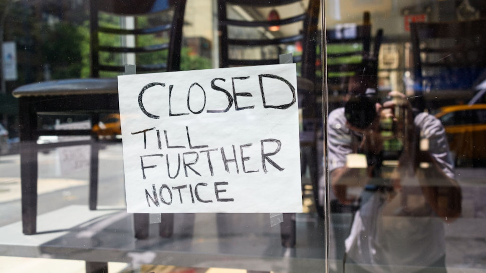 """NEW YORK, NEW YORK - JULY 28: A sign is posted at a restaurant that reads, """"closed till further notice"""" as the city continues Phase 4 of re-opening following restrictions imposed to slow the spread of coronavirus on July 28, 2020 in New York City. The fourth phase allows outdoor arts and entertainment, sporting events without fans and media production. (Photo by Noam Galai/Getty Images)"""
