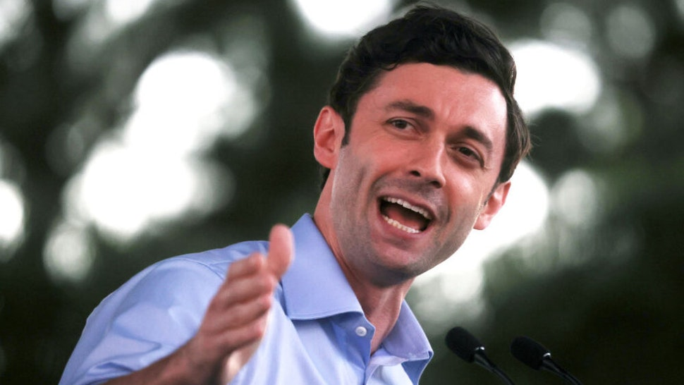 """COLUMBUS, GEORGIA - OCTOBER 29: Democratic U.S. Senate candidate Jon Ossoff speaks during a """"Get Out the Early Vote"""" drive-in campaign event on October 29, 2020 in Columbus, Georgia. With less than a week to go until Election Day, Democratic candidates for the U.S. Senate in Georgia are continuing to campaign throughout the state."""