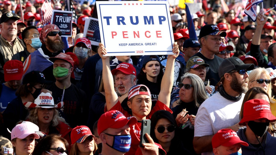 "People participate in the ""Million MAGA March"" from Freedom Plaza to the Supreme Court, on November 14, 2020 in Washington, DC."