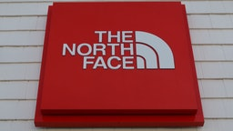 A The North Face sign hangs in front of their store at the Woodbury Common Premium Outlets shopping mall on November 24, 2020 in Central Valley, New York.