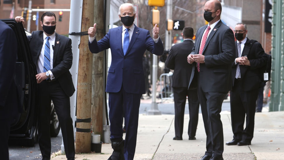 President-elect Joe Biden gestures as he leaves an event to name his economic team at the Queen Theater on December 1, 2020 in Wilmington, Delaware. Biden is nominating and appointing key positions of the team, including Janet Yellen to be Secretary of the Treasury.