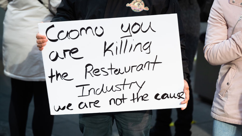 Restaurant owners and workers protest in Times Square against new regulations that ended indoor dining on December 15, 2020 in New York City.