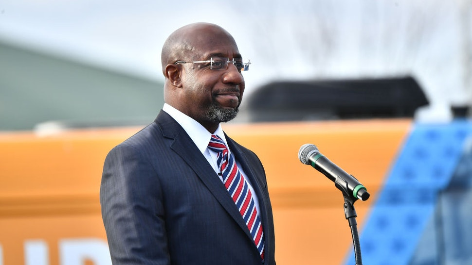 "Georgia Democratic Senate candidate Raphael Warnock speaks onstage during the ""Vote GA Blue"" concert for Georgia Democratic Senate candidates Raphael Warnock and Jon Ossoff on December 28, 2020 in Stonecrest, Georgia."