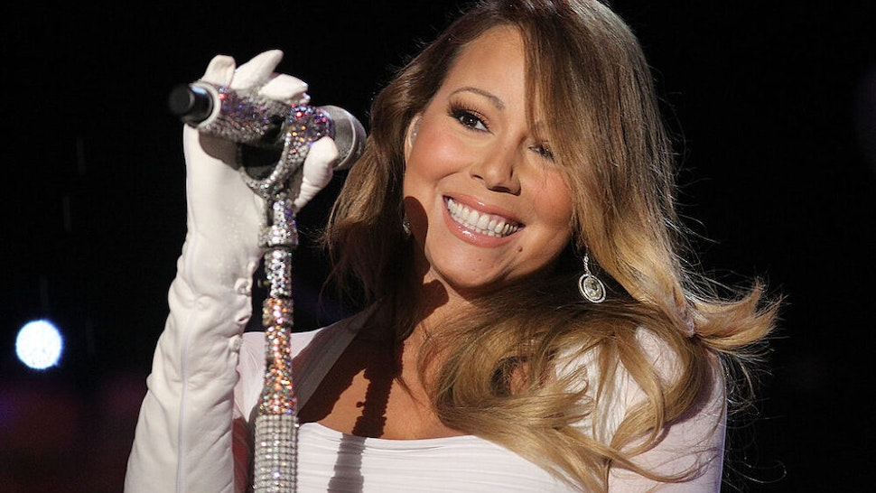 WASHINGTON, DC - DECEMBER 06: Mariah Carey performs during the National Christmas Tree Lighting Ceremony in President's Park on December 6, 2013 in Washington, DC.