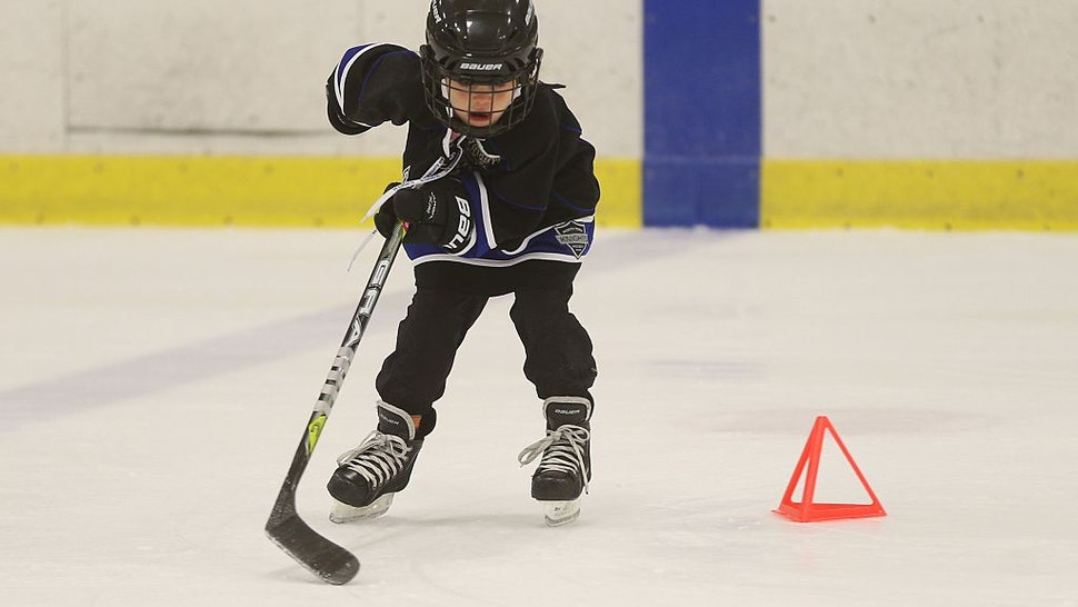 A little girl does some drills... A mother -daughter Skate/shinny was held today at Leaside Memorial Arena.