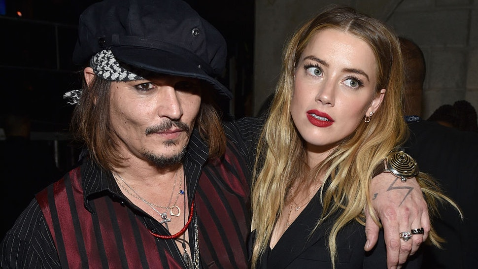 Actor/musician Johnny Depp (L) and actress Amber Heard attend The 58th GRAMMY Awards at Staples Center on February 15, 2016 in Los Angeles, California.