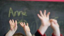 GLASGOW, SCOTLAND - JANUARY 28: Children wave their hands at a private nursery school January 28, 2005 in Glasgow, Scotland. The average price of pre-school care has increased over the past year, sending child care prices to an average of GBP200 in parts of the southeast. Many working parents in the UK have called for pre-school childcare subsidies such as those in France where nearly 100% of three-year-olds are in pre-school education, despite the fact that school attendance is not compulsory until they turn five.