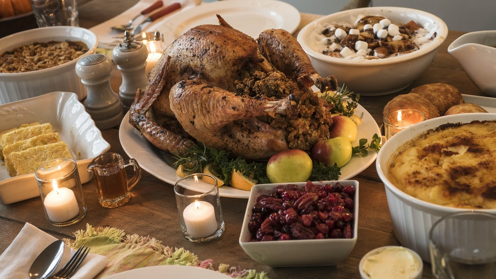 Dining table filled with thanksgiving food - stock photo