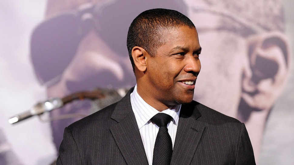 """HOLLYWOOD - JANUARY 11: Actor Denzel Washington arrives at the Premiere Of Warner Bros. """"The Book Of Eli"""" at Grauman's Chinese Theater on January 11, 2010 in Hollywood, Los Angeles, California."""