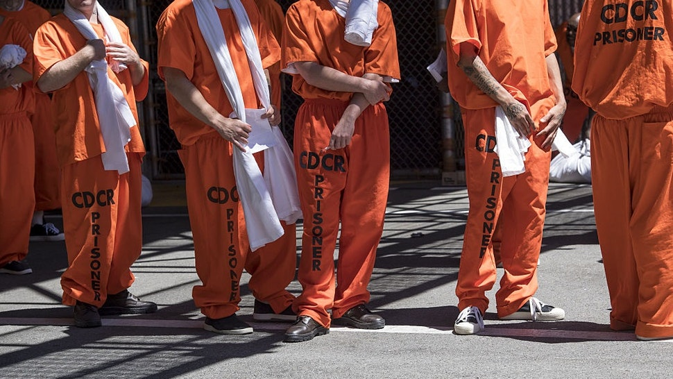 Inmates stand outside at San Quentin State Prison in San Quentin, California, U.S., on Tuesday, Aug. 16, 2016.