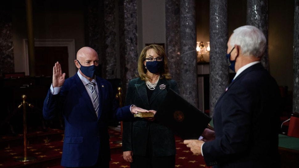 Senator Mark Kelly, a Democrat from Arizona, left, is ceremoniously sworn-in by U.S. Vice President Mike Pence, right, beside his wife, former congresswoman Gabrielle Giffords, on Capitol Hill in Washington, D.C., U.S., on Wednesday, Dec. 2, 2020. Kelly, a former astronaut, defeated Senator Martha McSally in a special election last month.