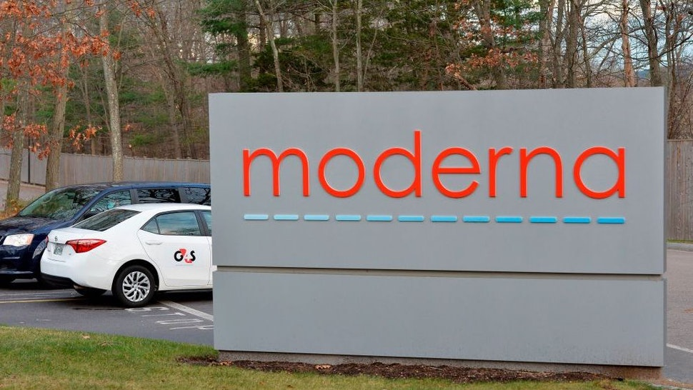 The Moderna logo is seen at the Moderna campus in Norwood, Massachusetts on on December 2, 2020, where the biotechnology company is mass producing its Covid-19 vaccine. - The US hopes to have immunized 100 million people against Covid-19 by the end of February, a top official said on December 2, which is approximately 40 percent of the country's adult population. The push should start within weeks, when vaccines developed by Pfizer-BioNTech and Moderna-NIH are expected to be approved.