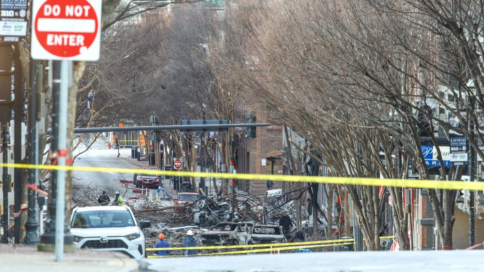 NASHVILLE, TENNESSEE - DECEMBER 25: Police close off an area damaged by an explosion on Christmas morning on December 25, 2020 in Nashville, Tennessee. A Hazardous Devices Unit was en route to check on a recreational vehicle which then exploded, extensively damaging some nearby buildings. According to reports, the police believe the explosion to be intentional, with at least 3 injured and human remains found in the vicinity of the explosion