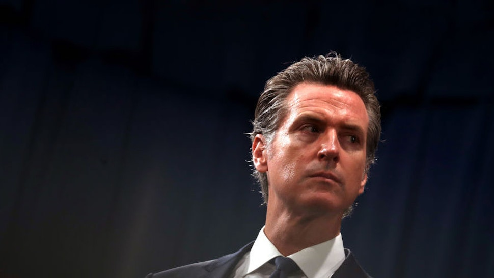 "SACRAMENTO, CALIFORNIA - AUGUST 16: California Gov. Gavin Newsom looks on during a news conference with California attorney General Xavier Becerra at the California State Capitol on August 16, 2019 in Sacramento, California. California attorney genera Xavier Becerra and California Gov. Gavin Newsom announced that the State of California is suing the Trump administration challenging the legality of a new ""public charge"" rule that would make it difficult for immigrants to obtain green cards who receive public assistance like food stamps and Medicaid."