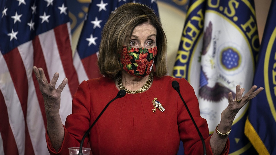 WASHINGTON, DC - DECEMBER 20: Speaker of the House Nancy Pelosi (D-CA) speaks during a press conference on Capitol Hill on December 20, 2020 in Washington, DC. Republicans and Democrats in the Senate finally came to an agreement on the coronavirus relief bill and a vote is expected on Monday.