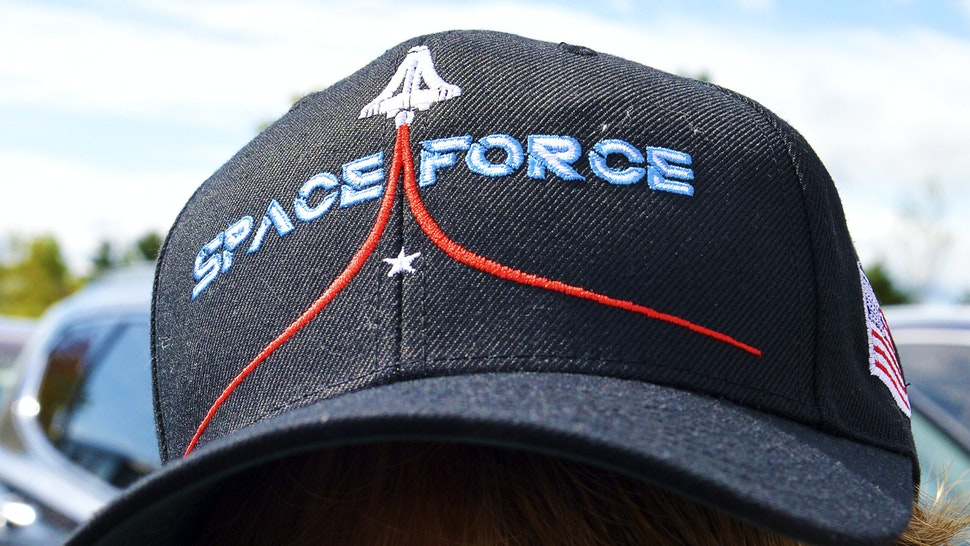A woman wears a Space Force hat while boarding a shuttle bus at the Manchester Mall going to Manchester Airport in Londonderry, New Hampshire on August 28, 2020. - US President Donald Trump is scheduled to speak to supporters in Londonderry on August 28.