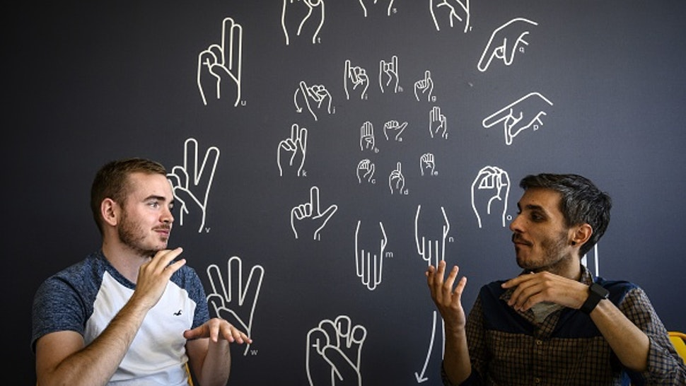 """Hearing-impaired students take part in a sign language webdesign course at """"Signes & Formations"""" on the Lyon Digital Campus, on May 22, 2019."""