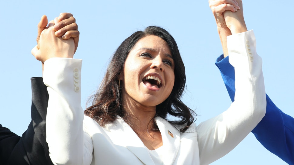 LOS ANGELES, CALIFORNIA - NOVEMBER 11: Democratic presidential candidate U.S. Rep. Tulsi Gabbard (D-HI) sings during the inaugural Veterans Day L.A. event held outside of the Los Angeles Memorial Coliseum on November 11, 2019 in Los Angeles, California. The stadium's historic torch was lit at the ceremony to mark the anniversary of the armistice which ended World War I in 1918. Gabbard is the first female combat veteran to run for the U.S. presidency.