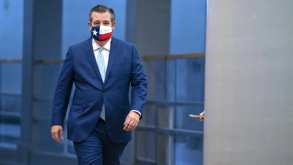 Senator Ted Cruz, a Republican from Texas, wears a protective mask as he walks in the Senate Subway of the U.S. Capitol ahead of a confirmation vote in Washington, D.C., U.S., on Monday, Oct. 26, 2020. The Senate voted 52-48 Monday to confirmAmy Coney Barrett to the U.S. Supreme Court, giving the court a 6-3 conservative majority that could determine the future of the Affordable Care Act and abortion rights.
