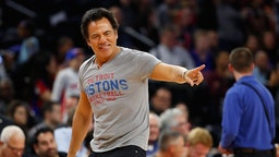 AUBURN HILLS, MI - OCTOBER 28: Detroit Pistons owner Tom Gores throws tee shits into the stands during the Detroit Pistons home opener against the Orlando Magic at the Palace of Auburn Hills on October 28, 2016 in Auburn Hills, Michigan.