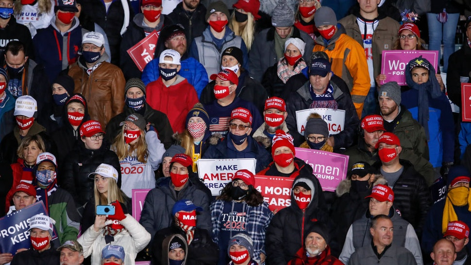 GRAND RAPIDS, MI - NOVEMBER 03: Supporters of the President Donald Trump listen as he speaks during a rally on November 3, 2020 in Grand Rapids, Michigan. Trump and Democratic presidential nominee Joe Biden are making last-minute stops in swing states ahead of tomorrow's general election. (Photo by Kamil Krzaczynski/Getty Images)