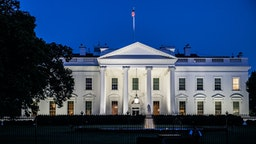 Horizontal color photo of White House in Washington DC on a clear summer evening