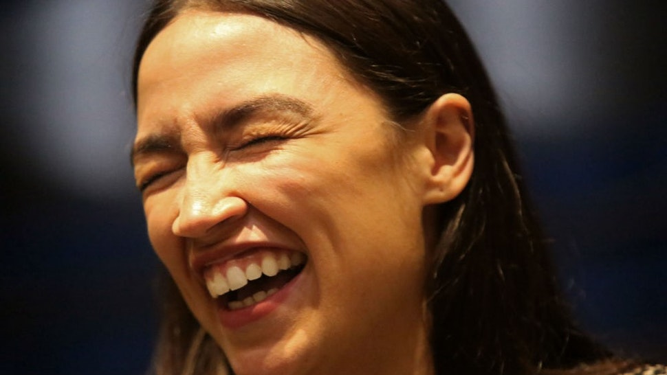 NEW YORK, NY - DECEMBER 14: Rep. Alexandria Ocasio-Cortez (D-NY) greets audience members after speaking at a Green New Deal For Public Housing Town Hall on December 14, 2019 in the Queens borough of New York City. (Photo by