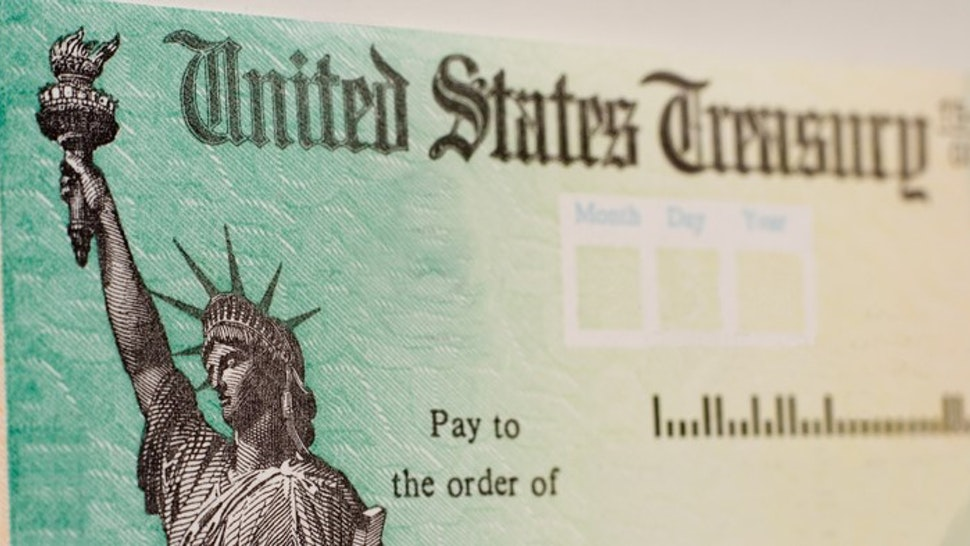 A blank US government check with selective focus on the statue of liberty