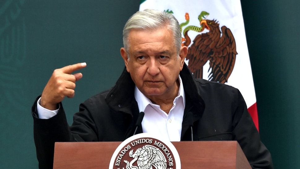 Mexico's President Andres Manuel Lopez Obrador, speaks during a meeting with relatives of the 43 students of the teaching training school in Ayotzinapa who went missing on September 26, 2014, at the National Palace in Mexico City on September 26, 2020 on the sixth anniversary of their disappearance. - The students had commandeered five buses to travel to a protest on the night of September 26, 2014, but were stopped by municipal police in the city of Iguala, Guerrero. Prosecutors initially said the officers delivered the 43 teacher trainees to drug cartel hitmen, who killed them, incinerated their bodies and dumped the remains in a river. However, independent experts from the Inter-American Commission on Human Rights have rejected the government's conclusion, and the unsolved case remains a stain on Mexico's reputation.