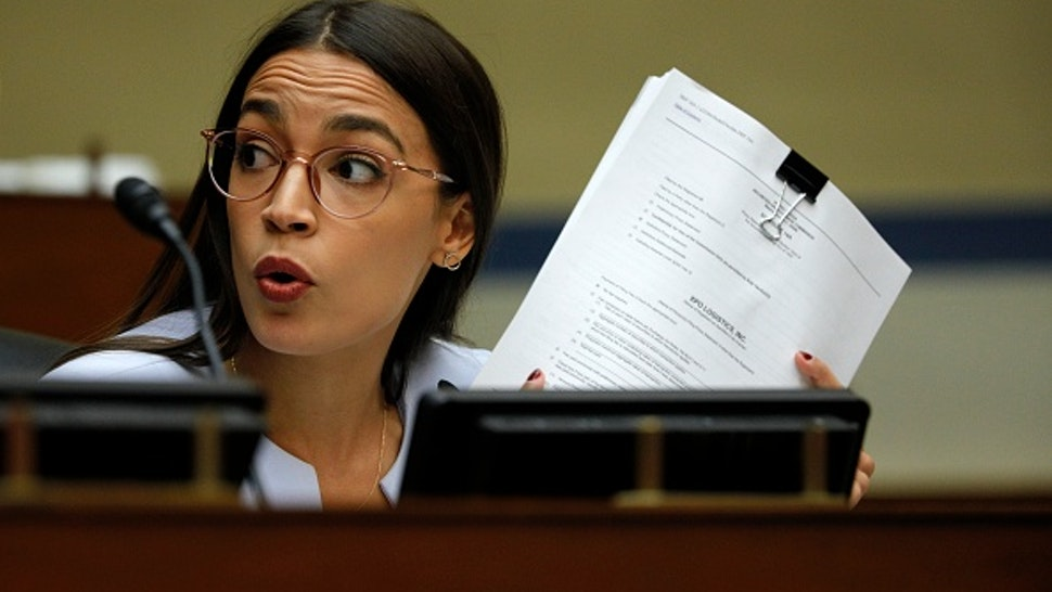 """WASHINGTON, DC - AUGUST 24: Rep. Alexandria Ocasio-Cortez (D-NY) asks a question as U.S. Postmaster General Louis DeJoy testifies at a House Oversight and Reform Committee hearing in the Rayburn House Office Building on August 24, 2020 on Capitol Hill in Washington, DC. The committee is holding a hearing on """"Protecting the Timely Delivery of Mail, Medicine, and Mail-in Ballots."""""""
