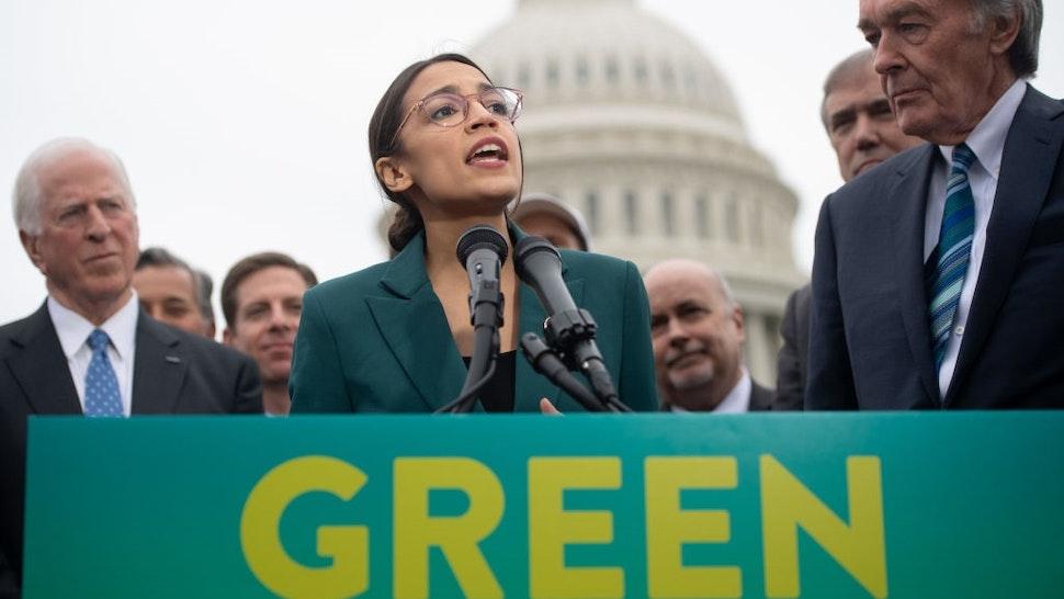 US Representative Alexandria Ocasio-Cortez, Democrat of New York, and US Senator Ed Markey (R), Democrat of Massachusetts, speak during a press conference to announce Green New Deal legislation to promote clean energy programs outside the US Capitol in Washington, DC, February 7, 2019.