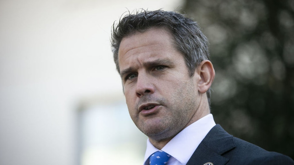 Representative Adam Kinzinger, a Republican from Illinois, speaks to members of the media following a meeting with U.S. President Donald Trump, not pictured, outside the White House in Washington, D.C., U.S., on Wednesday, March 6, 2019. SenatorChuck Grassleyof Iowa, one of the few Republicans with the power to request President Trump's tax returns wants to make sure that if House Democrats are successful in getting them, he wants to see them, too. Photographer: Al Drago/Bloomberg
