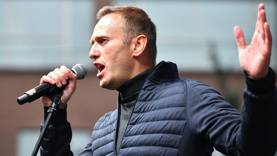 "Russian opposition leader Alexei Navalny gestures as he delivers a speech during a demonstration in Moscow on September 29, 2019. - Thousands gathered in Moscow for a demonstration demanding the release of the opposition protesters prosecuted in recent months. Police estimated a turnout of 20,000 people at the Sakharov Avenue in central Moscow about half an hour after the start of the protest, which was authorised. The demonstrators chanted ""let them go"" and brandished placards demanding a halt to ""repressions"" of opposition protesters."