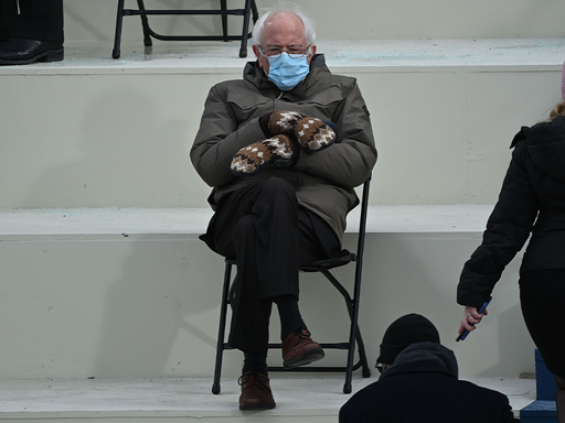 TOPSHOT - Former presidential candidate, Senator Bernie Sanders (D-Vermont) sits in the bleachers on Capitol Hill before Joe Biden is sworn in as the 46th US President on January 20, 2021, at the US Capitol in Washington, DC.