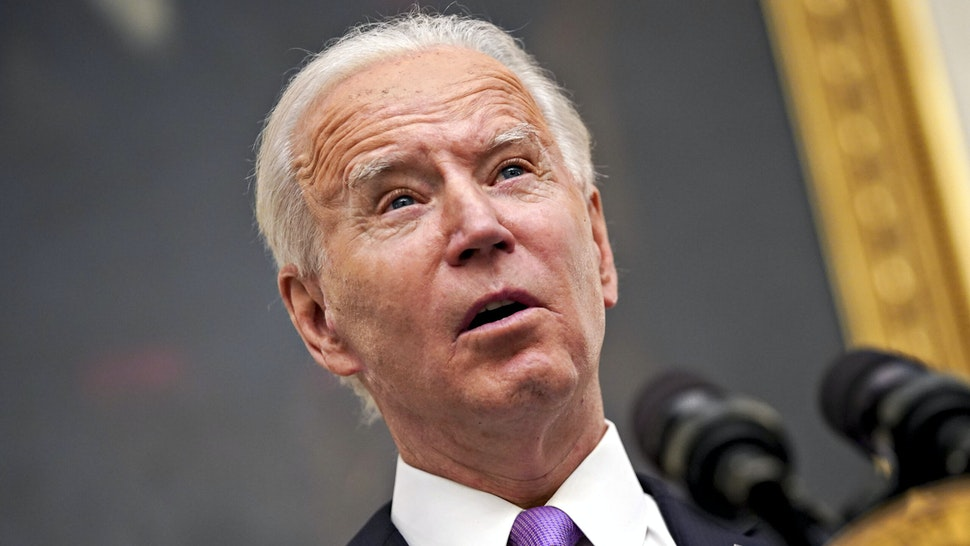 U.S. President Joe Biden speaks during an event on his administration's Covid-19 response in the State Dining Room of the White House in Washington, D.C., U.S., on Thursday, Jan. 21, 2021. Biden in his first full day in office plans to issue a sweeping set of executive orders to tackle the raging Covid-19 pandemic that will rapidly reverse or refashion many of his predecessor's most heavily criticized policies.