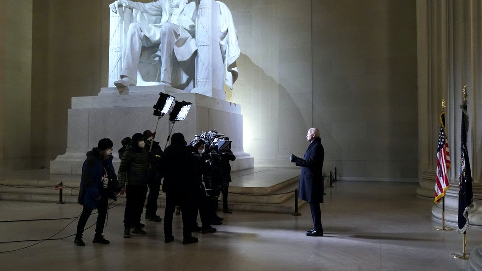 """US President Joe Biden speaks during the """"Celebrating America"""" inaugural program at the Lincoln Memorial in Washington, DC, on January 20, 2021, after being sworn in at the US Capitol earlier in the day."""