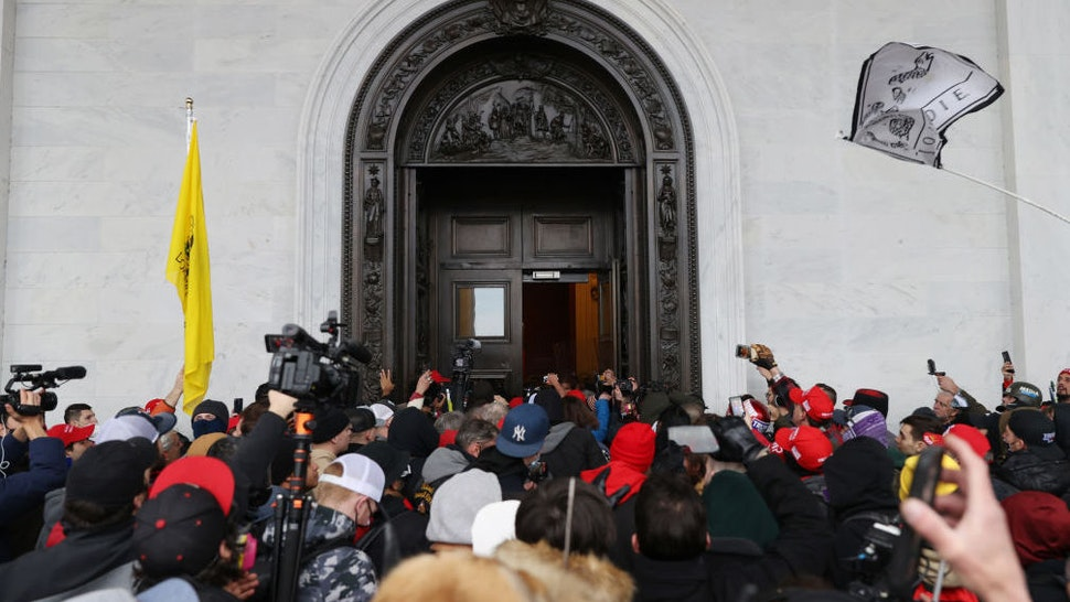 WASHINGTON, DC - JANUARY 06: Protesters gather at the door of the U.S. Capitol Building on January 06, 2021 in Washington, DC. Pro-Trump protesters entered the U.S. Capitol building after mass demonstrations in the nation's capital during a joint session Congress to ratify President-elect Joe Biden's 306-232 Electoral College win over President Donald Trump.