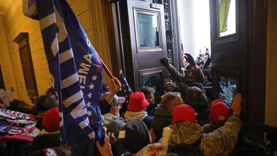 WASHINGTON, DC - JANUARY 06: Protesters supporting U.S. President Donald Trump break into the U.S. Capitol on January 06, 2021 in Washington, DC.