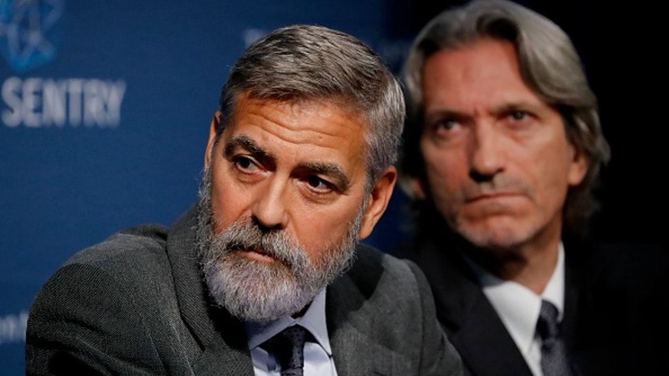 US actor George Clooney takes part in a press conference in central London to present a report on atrocities in South Sudan on September 19, 2019.