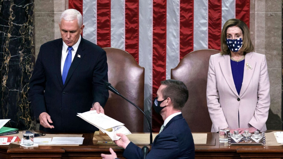 Vice President Mike Pence and House Speaker Nancy Pelosi preside over a Joint session of Congress to certify the 2020 Electoral College results after supporters of President Donald Trump stormed the Capitol earlier in the day on Capitol Hill in Washington, DC on January 6, 2020. - Members of Congress returned to the House Chamber after being evacuated when protesters stormed the Capitol and disrupted a joint session to ratify President-elect Joe Biden's 306-232 Electoral College win over President Donald Trump.